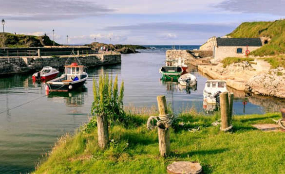 Boats moored in Ballintoy Harbour/