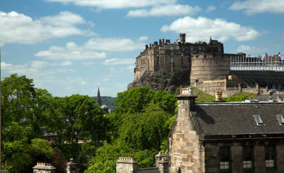 View across trees and roof tops to Edinburgh Castle/