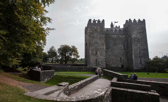 People wandering round the grounds of Bunratty Castle in Co Clare/