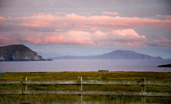 View over a fence across the sea to Achill Island, Co Mayo/