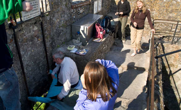 People waiting to kiss the Blarney Stone at Blarney Castle /