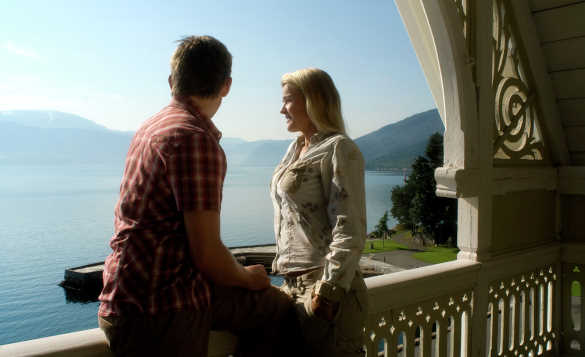 Couple standing on a Kviknes Hotel balcony and enjoying the view across the fjord/