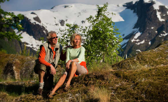 Couple relaxing after walking through the hills and mountains in Norway/