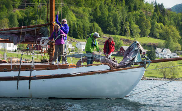 Family setting out on a sailing trip on the Sognefjord in Norway/