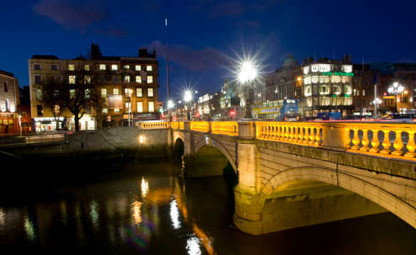 Nightime view of bridge over the River Liffey in Dublin/