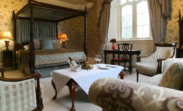 Large luxurious bedroom at Kilronan Castle with large four poster bed /