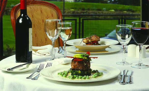 Tabel set with wine and two meals served at the Knockranny House Hotel/