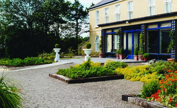 Gravel pathway leading through flower beds to the entrance to Sheedys Hotel, Lisdoonvarna/