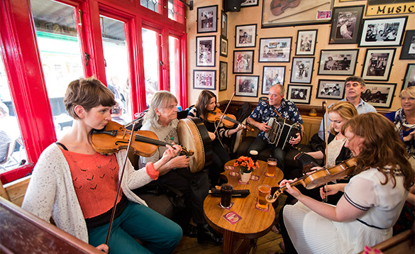 Group of musicians playing in a traditional Irish pub/