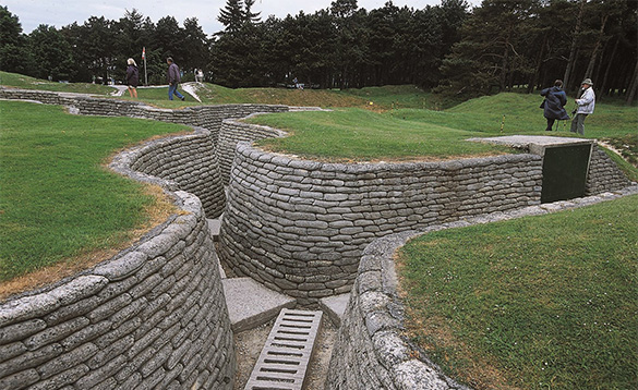 Preserved world war 1 trenches with concrete sandbags and ladders depicting life in the trenches/