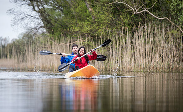 Couple in a canoe paddling on Lough Erne/
