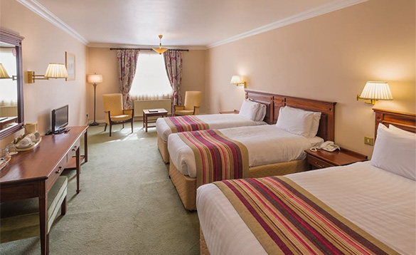 Bedroom at the Londonderry Arms Hotel, Co Antrim with three single beds/