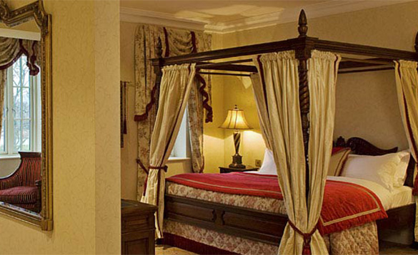 Luxurious bedroom at the Lough Erne Golf Resort Hotel with four poster double bed/