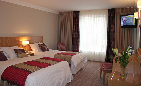 Bedroom at the Wellington Park Hotel, Belfast with a double and single bed/