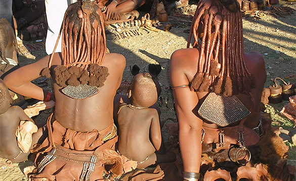 Himba ladies sitting on the floor in Namibia/
