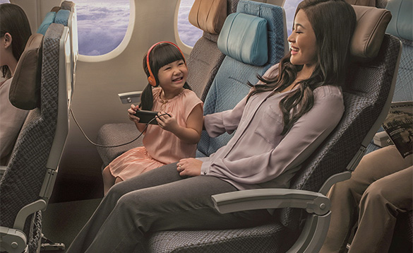 A woman and a child on a plane /