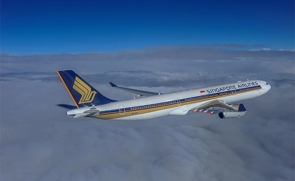 Singapore airlines plane flying above white clouds/