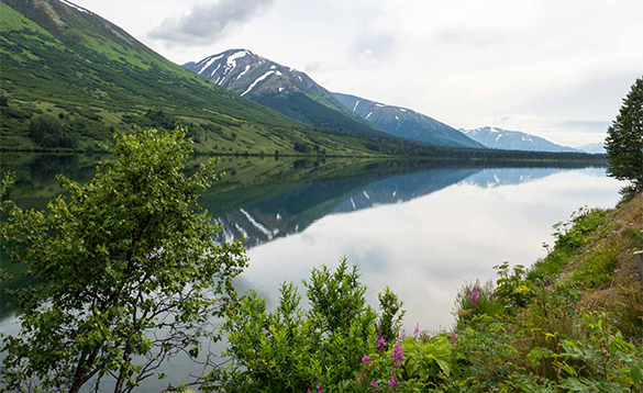 Mountains reflected in a lake in the Yukon/