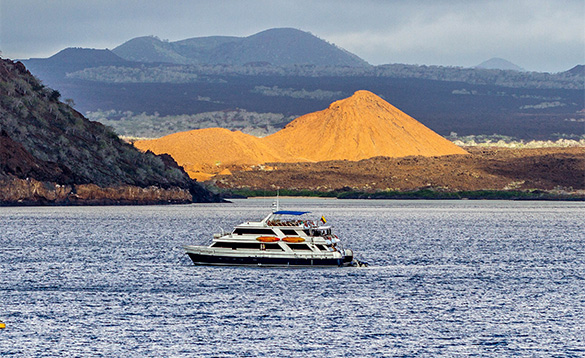 boat sailing past the Galapagos Islands/