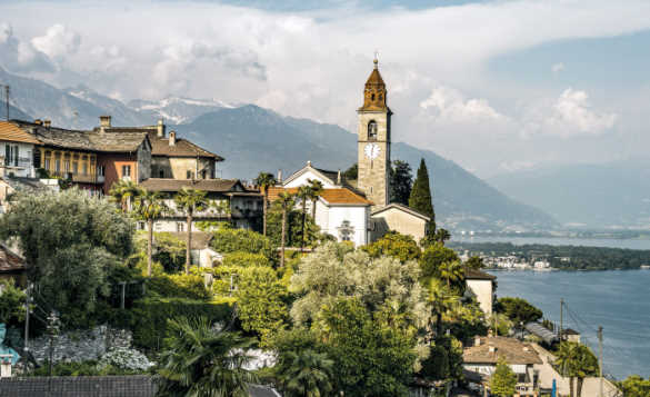 View of a village set on top of a hill with Lake Maggiore in the background, Switzerland/