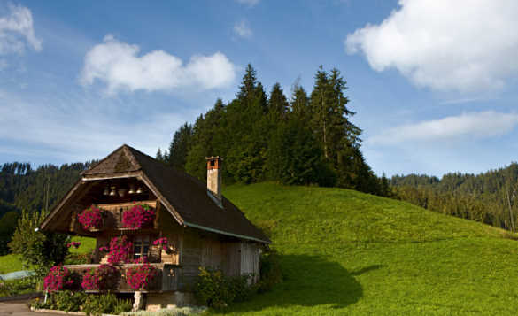 Swiss chalet with flower filled window boxes in the Zulg Valley, Bernese Oberland, Switzerland/