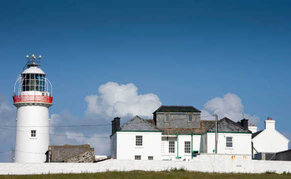 White buildings and lighthouse tower of the Loophead Lighthouse in Co Clare/