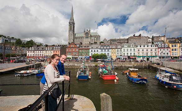Couple looking over a harbour in Co Cork/