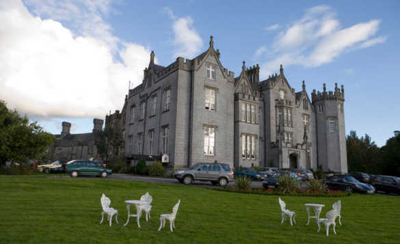 Cars parked outside Kinnitty Castle in Co Offaly, Ireland/