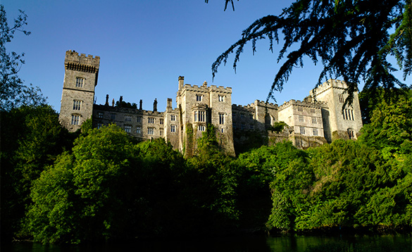 View across trees to Lismore Castle, Co Waterford, Ireland/