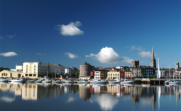 View across a river to the Waterford Quays/