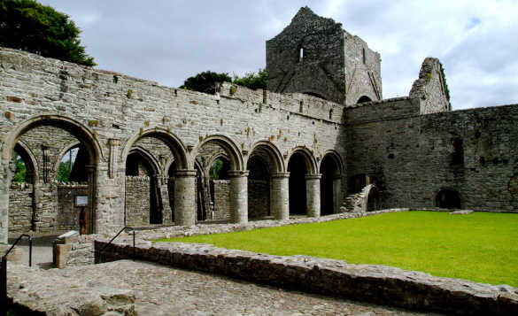 Stone walkway beside a lawn leading through the ruins of Boyle Abbey, Co Roscommon/