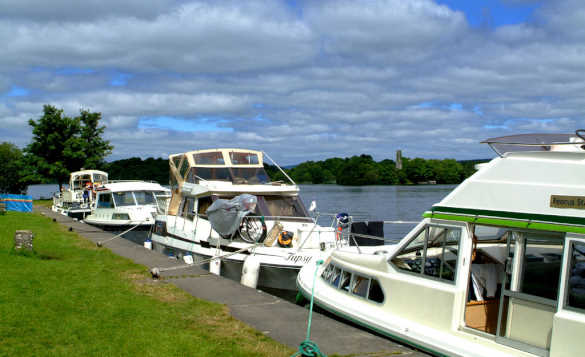 Cruiser boats moored along a quay beside Lough Key/