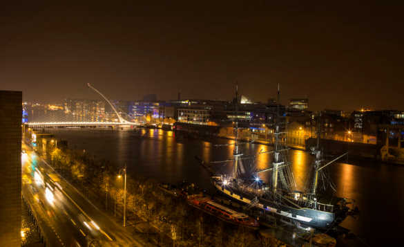 Nightime view across the River Liffey to a brightly lit Dublin/