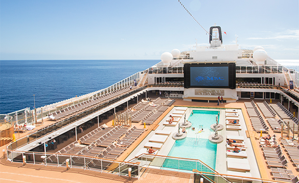 Passengers relaxing by a pool on MSC Meraviglia/