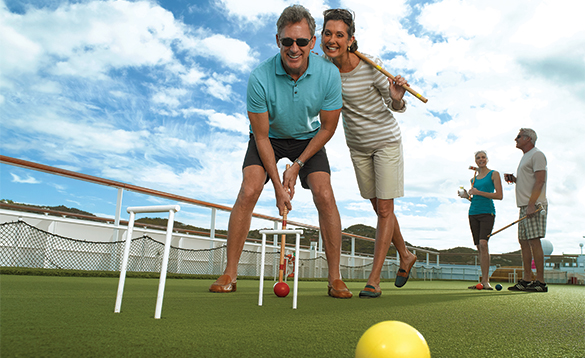 Two couples playing croquet onboard an Oceania cruise ship/