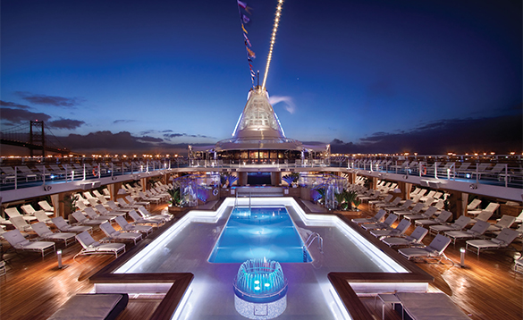 The large heated pool lit at night on an Oceania cruise ship/