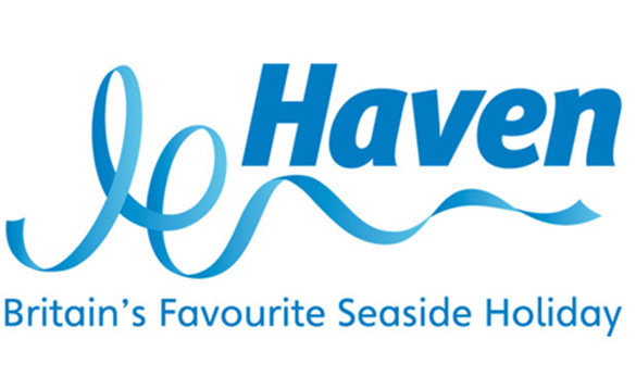 white backgound with holiday park logo - 'Haven Britain's Favourite Seaside Holiday' logo in blue lettering/