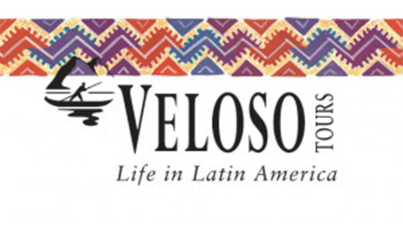logo of veloso tours with a patchwork effect band across the top with purple, orange and blue squares/