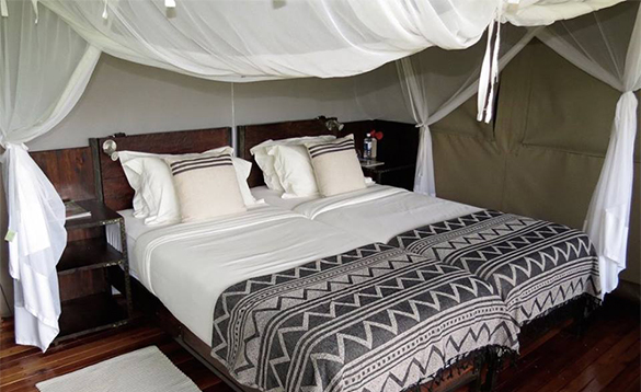 Bedroom at Sango Safari Camp in Botswana/