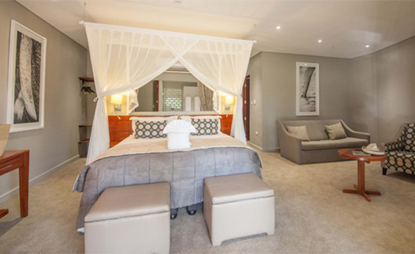 Guest bedroom with double bed at Chobe Bush Lodge/