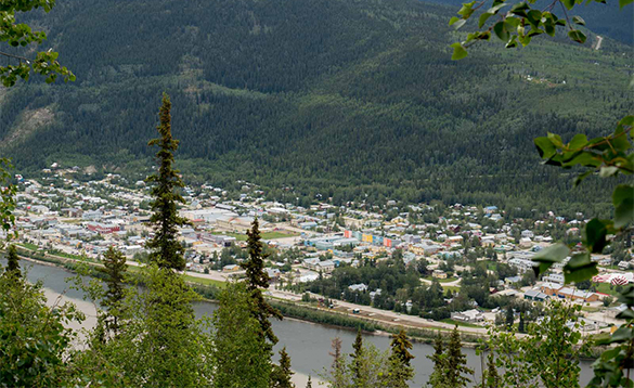 River passing past a town in the Yukon/