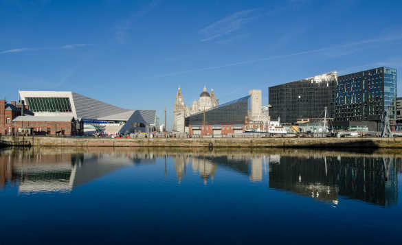 View across water to Liverpools Pier Head/