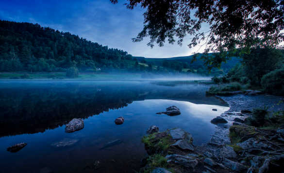 A misty morning over a lake in Glendalough, Co Wicklow, Ireland/