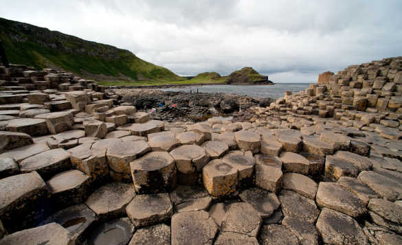 The polygonal stones of the Giant's Causeway leading to the sea/