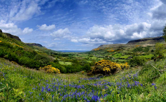 View across the fields and meadows and hills of the Glens of Antrim /