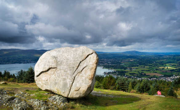 A large stone on a grassy hillside in the Mourne Mountains, Co Down/