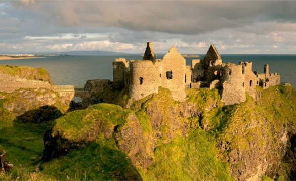 The ruins of Dunluce Castle overlooking the sea/