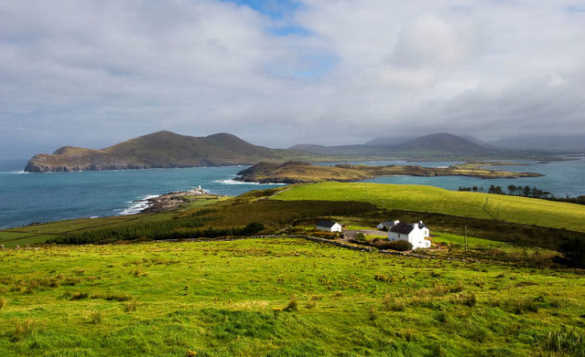 Scenic landscape of the Ring of Kerry with white cottages beside the coast/