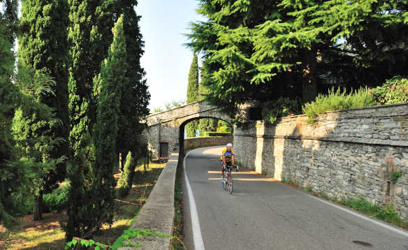Cyclist cycling along a road in Moltrasio, Lake Como/