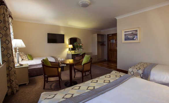 Large family bedroom with double and two single beds at the Breffni Arms Hotel, Arva/